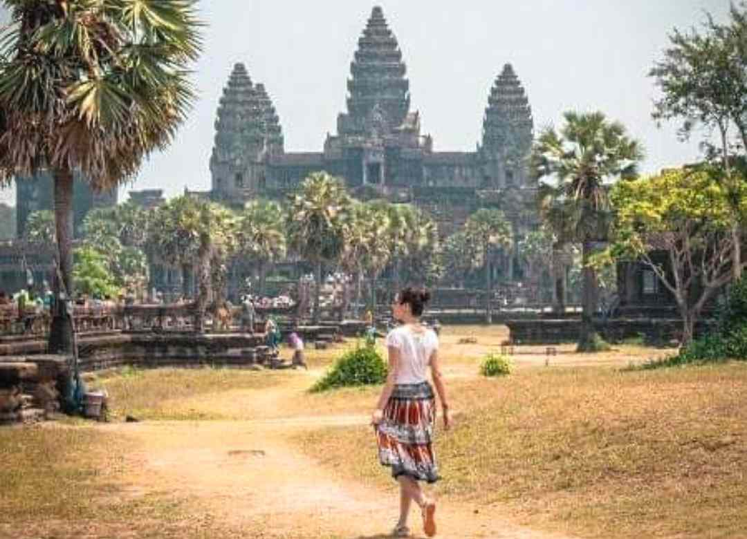 A women traveler in Angkor wat Temple on Cambodia solo vacation